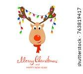 head of happy reindeer with red ... | Shutterstock .eps vector #763819417
