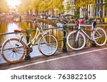 bike over canal amsterdam city. ... | Shutterstock . vector #763822105