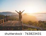 happy of man standing alone... | Shutterstock . vector #763823431