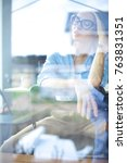 young woman sitting at office... | Shutterstock . vector #763831351