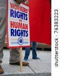 Small photo of DALLAS - MAY 1, 2011: An unidentified demonstrator holds a pro-workers' rights sign from the AFL-CIO during a May Day protest on May 1, 2011 in Dallas, Texas.