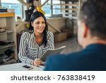 Small photo of Woman consultant talking with client in office.