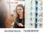 smiling young woman trying on... | Shutterstock . vector #763838509