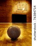 Basketball on wooden floor of old basketball court - stock photo