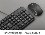 black computer mouse near the... | Shutterstock . vector #763856875