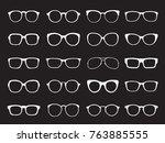 set of white glasses isolated.... | Shutterstock .eps vector #763885555