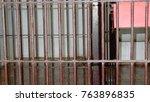 steel bars of prison bars  jail ... | Shutterstock . vector #763896835