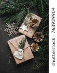 christmas presents on dark... | Shutterstock . vector #763929904