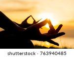 close up hands. woman do yoga...   Shutterstock . vector #763940485
