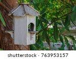 White Birdhouse On The Tree