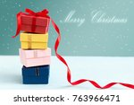 christmas gift box on wood... | Shutterstock . vector #763966471