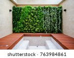 bathroom with wall of plants... | Shutterstock . vector #763984861