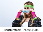woman in 1980's fashion on a...   Shutterstock . vector #764011081