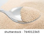 ladling pile of dry yeast with... | Shutterstock . vector #764012365