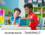 two boy kid sit on table and... | Shutterstock . vector #764039617