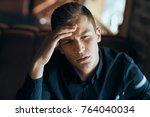 pensive man  portrait. | Shutterstock . vector #764040034