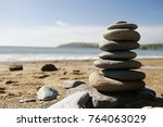 a pile of balanced stones on... | Shutterstock . vector #764063029