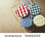 top view of jars with colorful... | Shutterstock . vector #764063335