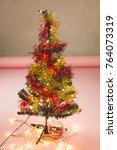 small plastic christmas tree... | Shutterstock . vector #764073319
