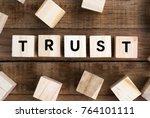 word trust on a wooden block | Shutterstock . vector #764101111