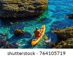 senior kayaker on a kayak by... | Shutterstock . vector #764105719