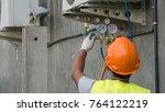 technician is checking outdoor...   Shutterstock . vector #764122219