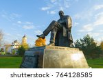 Small photo of Staraya Russa, Russia - January 8, 2016 - a monument to the famous Russian writer Fyodor Mikhailovich Dostoyevsky in sunny autumn day.