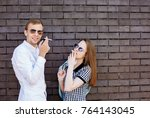 beautiful girl and handsome guy ... | Shutterstock . vector #764143045