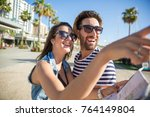 happy woman holding map showing ... | Shutterstock . vector #764149804