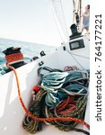 Small photo of Running and rigging of nautical marine ropes pile on yacht or sailboat deck, strong and resistant cords, dyneema and spectra