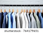 male jackets and shirts hanging ... | Shutterstock . vector #764179651