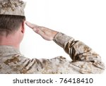 Marine In Desert Fatigues Saluting - stock photo