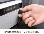 person tuning white radio ...   Shutterstock . vector #764184187