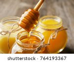 Pouring Aromatic Honey Into Ja...
