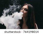 brunette woman vaping...   Shutterstock . vector #764198014