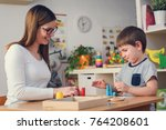 woman looking at kid playing... | Shutterstock . vector #764208601