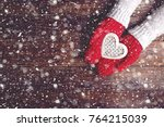 womans hands in red gloves... | Shutterstock . vector #764215039
