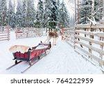 reindeer with sleigh in winter... | Shutterstock . vector #764222959