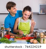 happy young man and woman near...   Shutterstock . vector #764224219