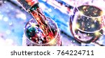 pouring wine. christmas wine.... | Shutterstock . vector #764224711