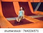 young woman sportsman jumping...   Shutterstock . vector #764226571