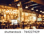 table in blur pub or bar and...   Shutterstock . vector #764227429
