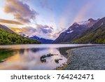 Lake Gunn at sunrise with beautiful sun rays, Fiordland, South Island, New Zealand