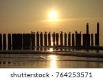 sunset at north sea in germany | Shutterstock . vector #764253571