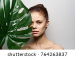 young woman with a palm leaf   ... | Shutterstock . vector #764263837