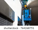 Small photo of Worker maintain service on high rise building.
