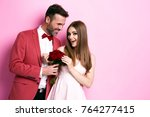 affectionate couple celebrating ... | Shutterstock . vector #764277415