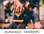 close up of barman hand pouring ... | Shutterstock . vector #764280091