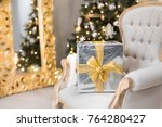 big silver gift with gold bow... | Shutterstock . vector #764280427