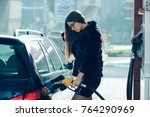 beautiful girl poured fuel into ...   Shutterstock . vector #764290969